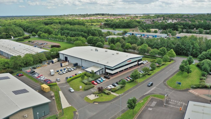 An aerial photograph of a commercial warehouse to be advertised in a commercial brochure giving that greater perspective of the site