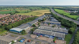 Industrial estate warehouses in context with the motorway
